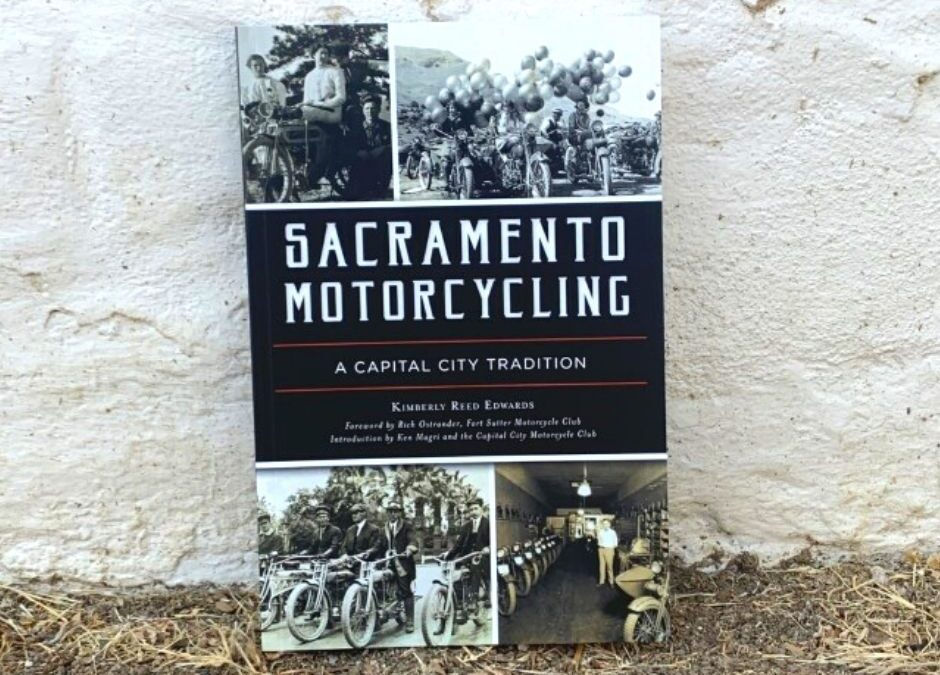 Sacramento Motorcycling Book cover against the adobe walls of Sutter's Fort
